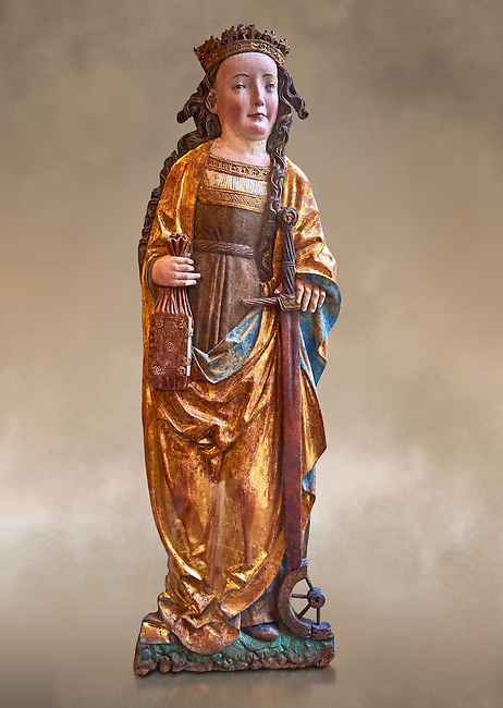 Painted Gothic gilded wooden statue altarpiece of Saint Catherine, circa 1520-1525 by Niklaus Weckmann from Ulm, Germany. The young Christian martyr is represented with his usual attributes, crown, book, wheel, sword, which make reference to her legendary life and her martyrdom. The bas-relief of Saint Catherine was originally part of an altarpiece. The treatment  and refined painted facial highlights executed the prettiness of the saint. The style is typical of  Niklaus Weckmann, one great masters of late Gothic Swabian art . Inv RF 2207.6,  The Louvre Museum, Paris.