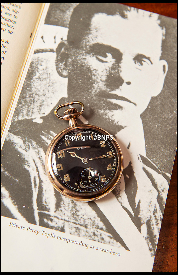 BNPS.co.uk (01202 558833)Pic : PhilYeomans/BNPS<br /> The watch along with a photograph of Toplis.<br /> <br /> The pocket watch worn by an infamous WW1 conman known as the 'Monocled Mutineer' has been sold for £1200.<br /> <br /> The timepiece belonged to disgraced Percy Toplis, a lowly private who when on leave wore a monocle to pretend he was a decorated officer.<br /> <br /> Toplis sold the watch, which has a fake engraving on the back awarding himself a DCM, to a hoodwinked nurse in 1916.<br /> <br /> In 1915 he had even tricked his home town of Blackwell in Notts to giving him a hero's welcome and a civic reception in his honour.<br /> <br /> Such was his notoriety that the BBC made a drama series of his notorious exploits in the 1980's.<br /> <br /> H.Aldridge auctioneers sold the watch, along with a letter of provenance from nurse Emily Philpott explaining the deception, at the weekend.