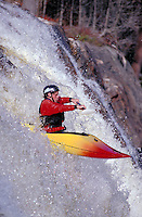 Whitewater kayak running Auger Falls on the Moose River. Lyons Falls New York United States Moose River - Adirondacks.