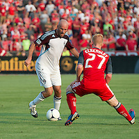 18 July 2012: Colorado Rapids forward Conor Casey #9 and Toronto FC defender Richard Eckersley #27 in action during an MLS game between the Colorado Rapids and Toronto FC at BMO Field in Toronto..Toronto FC won 2-1..