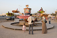 Tripoli, Libya, North Africa - Children on Amusement Park Ride.