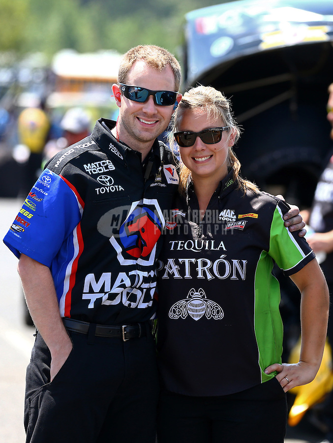 Jun. 2, 2013; Englishtown, NJ, USA: NHRA crew member (right) for funny car driver Alexis DeJoria and crew member for top fuel dragster driver Antron Brown during the Summer Nationals at Raceway Park. Mandatory Credit: Mark J. Rebilas-