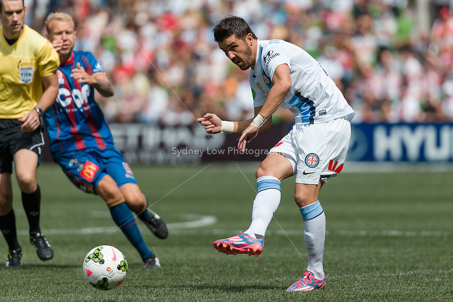 Spanish player David VILLA of Melbourne City passes the ball in the round 2 match between Melbourne City and Melbourne Victory in the Australian Hyundai A-League 2014-15 season at AAMI Park, Melbourne, Australia.