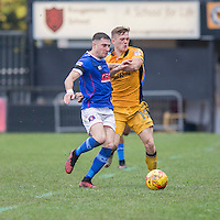 Mike Jones of Carlisle holds off Rhys Healey of Newport County during the Sky Bet League 2 match between Newport County and Carlisle United at Rodney Parade, Newport, Wales on 12 November 2016. Photo by Mark  Hawkins.