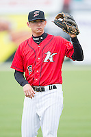Zachary Voight (8) of the Kannapolis Intimidators warms up in the outfield prior to the game against the Greenville Drive at CMC-Northeast Stadium on April 6, 2014 in Kannapolis, North Carolina.  The Intimidators defeated the Drive 8-5.  (Brian Westerholt/Four Seam Images)