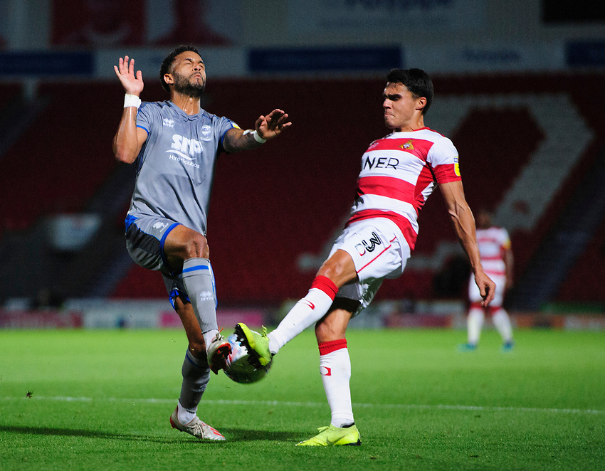 Lincoln City's Bruno Andrade vies for possession with Doncaster Rovers' Reece James<br /> <br /> Photographer Chris Vaughan/CameraSport<br /> <br /> EFL Leasing.com Trophy - Northern Section - Group H - Doncaster Rovers v Lincoln City - Tuesday 3rd September 2019 - Keepmoat Stadium - Doncaster<br />  <br /> World Copyright © 2018 CameraSport. All rights reserved. 43 Linden Ave. Countesthorpe. Leicester. England. LE8 5PG - Tel: +44 (0) 116 277 4147 - admin@camerasport.com - www.camerasport.com