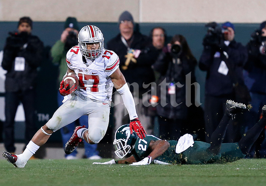 Ohio State Buckeyes running back Jalin Marshall (17) dodges a tackle from Michigan State Spartans safety Kurtis Drummond (27) as he returns a kick in the second quarter of the college football game between the Ohio State Buckeyes and the Michigan State Spartans at Spartan Stadium in East Lansing, Saturday night, November 8, 2014. As of half time the Ohio State Buckeyes led the Michigan State Spartans 28 - 21. (The Columbus Dispatch / Eamon Queeney)