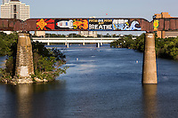 AUSTIN, TEXAS - Visible from the Lady Bird Hike and Bike Trail the Austin Railroad Graffiti Bridge over Lady Bird Town Lake contains some of Austin's most famous and cherished graffiti mural paintings.