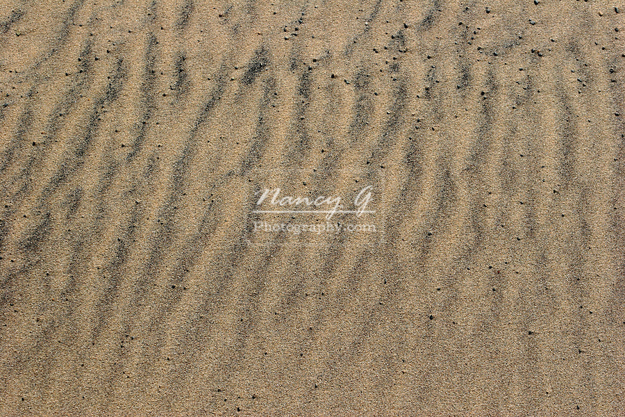 Sand crystals in a wave pattern at the beach on the shore of Lake Superior
