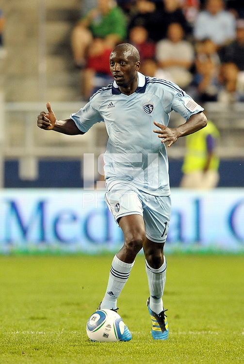 Sporting KC defender Lawrence Olum (13) in action... Sporting Kansas City and Chivas Guadalajara played to a 2-2 tie in an international friendly at LIVESTRONG Sporting Park, Kansas City, Kansas.