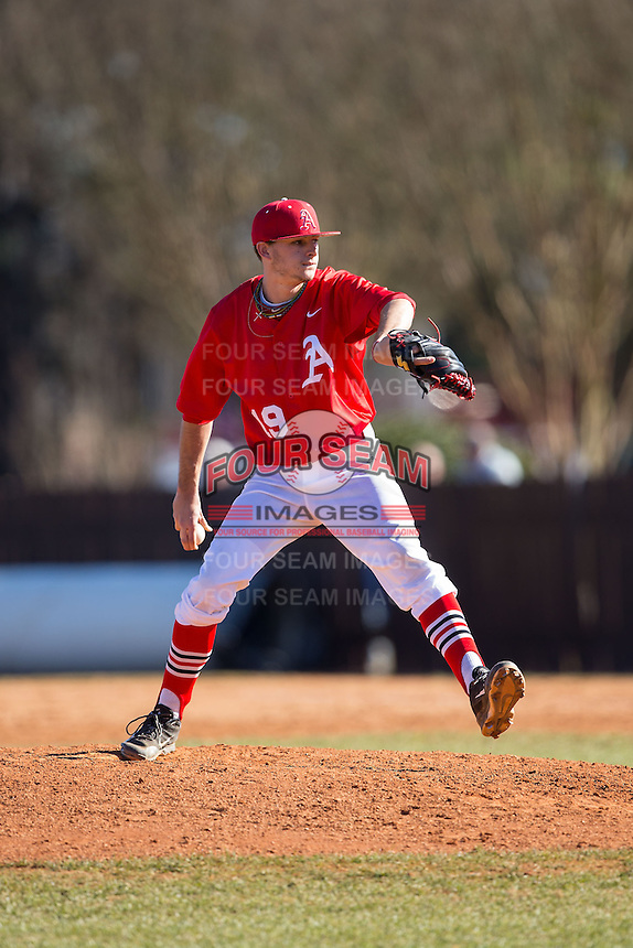 Belmont Abbey Crusaders relief pitcher Ross Garrett (19) in action against the Shippensburg Raiders at Abbey Yard on February 8, 2015 in Belmont, North Carolina.  The Raiders defeated the Crusaders 14-0.  (Brian Westerholt/Four Seam Images)