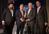 United States House Majority Leader Steny Hoyer (Democrat of Maryland), second right, accepts the 2019 Lamplighter Award from Rabbi Levi Shemtov, Executive Vice President of the American Friends of Lubavitch (Chabad), left, during a gala dinner at the Organization of American States in Washington, DC on Tuesday, June 18, 2019.  From left to right: Rabbi Shemtov, US Senator Roy Blunt (Republican of Missouri), Leader Hoyer, and Howard Friedman, prominent Jewish Community Leader and former President of AIPAC,<br /> Credit: Ron Sachs / CNP