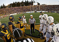 California and Northwestern captains watch referee Land Clark tosses a coin before the game at Memorial Stadium in Berkeley, California on August 31st, 2013.  Northwestern defeated CAL, 44-30.