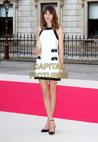 Alexa Chung.Royal Academy Summer Exhibition Preview party at the Royal Academy of Arts, Piccadilly, London, England..May 30th 2012.full length white dress ankle strap shoes black beige clutch bag black trim pockets.CAP/ROS.©Steve Ross/Capital Pictures.