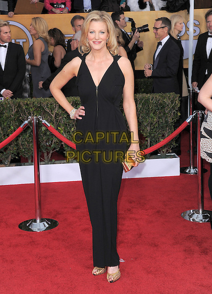 Anna Gunn.Arrivals at the 19th Annual Screen Actors Guild Awards at the Shrine Auditorium in Los Angeles, California, USA..27th January 2013.SAG SAGs full length dress  gold black clutch bag hand on hip.CAP/DVS.©DVS/Capital Pictures.