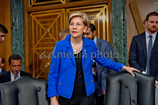 "United States Senator Elizabeth Warren (Democrat of Massachusetts) arrives to hear Richard F. Smith, former Chairman and Chief Executive Officer, Equifax, Inc. give testimony before the US Senate Committee on Banking, Housing, and Urban Affairs as they conduct a hearing entitled, ""An Examination of the Equifax Cybersecurity Breach"" on Capitol Hill in Washington, DC on Tuesday, October 3, 2017. Photo Credit: Ron Sachs/CNP/AdMedia"