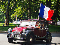 Members of the Greater New York Citorën and Velosolex Touring Club bring out their lovingly restored Citroën automobiles for their Bastille Day Rendez-Vous, seen on Riverside Drive in New York on Sunday, July 14, 2013. The parade of over a dozen Citroëns, including 2CV, DB series models, a truck and a traction avant started on Riverside Drive and traveled through the streets of Manhattan. The owners are dedicated to restoring and caring for their vehicles and share tips and information on repairing and restoring them. (© Frances M. Roberts)