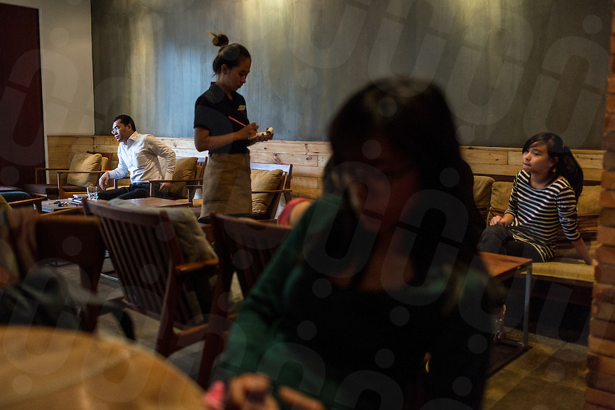 January 24, 2014 - Phnom Penh, Cambodia. People have a drink in a popular cafe, 'Browns' © Nicolas Axelrod / Ruom