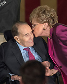 Former United States Senator Elizabeth Dole (Republican of North Carolina) kisses her husband, former US Senator Bob Dole (Republican of Kansas) after making remarks at a Congressional Gold Medal ceremony in his honor that is also attended by US President Donald J. Trump in the Rotunda of the US Capitol on Wednesday, January 17, 2017.  Congress commissioned gold medals as its highest expression of national appreciation for distinguished achievements and contributions.  Dole served in Congress from 1961 through 1996, was the Senate GOP leader from 1985 through 1996, and was the 1996 Republican Party nominee for President of the United States.<br /> Credit: Ron Sachs / CNP