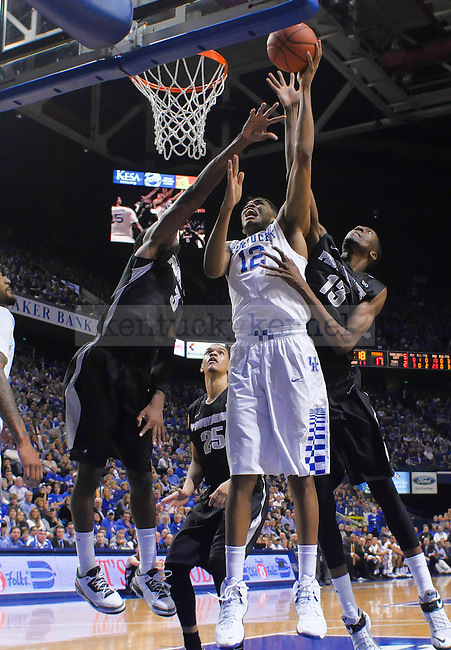 Karl-Anthony Towns (12) of the Kentucky Wildcats shoots a contested shot during the game against the Providence Friars at Rupp Arena on Sunday, November 30, 2014 in Lexington, Ky. Kentucky defeated Providence 58-30. Photo by Ben Rickard | Staff