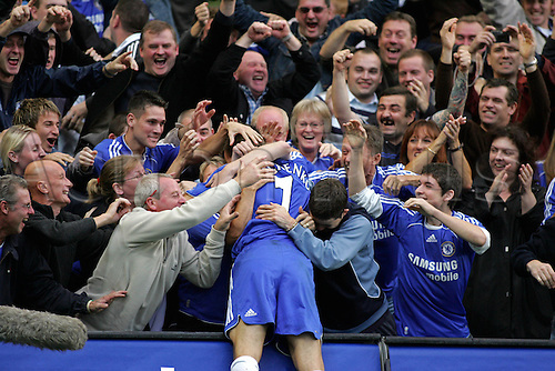 21 October 2006: Chelsea striker Andriy Shevchenko celebrates his first goal at Stamford Bridge with fans during the Premiership game between Chelsea and Portsmouth played at Stamford Bridge. Shevchenko was booked for this celebration. Chelsea won the match 2-1. Photo: Actionplus....061021 football soccer player joy celebration crowd fan supporter