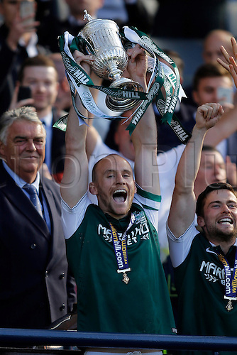 21.05.2016. Hamden Park, Glasgow, Scotland. Scottish Cup Final. Rangers versus Hibernian. Hibernian's Captain David Gray (2) Lifts the Scottish Cup after their 3-2 win