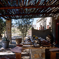 The large covered terrace provides a lovely shady spot for meals