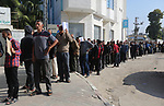Palestinian employees of Gaza strip wait to receive their salaries at a Post Office in Khan Younis in the southern of Gaza Strip, on November 9, 2018. Officials in Gaza said that NIS 90 million in funds from Qatar were transferred to the territory. Government employees receive their salaries for the month of August on Friday. Their salaries for September and October are to be paid soon as well. The Qatari funds are for civilian employees only and not security services. Photo by Ashraf Amra