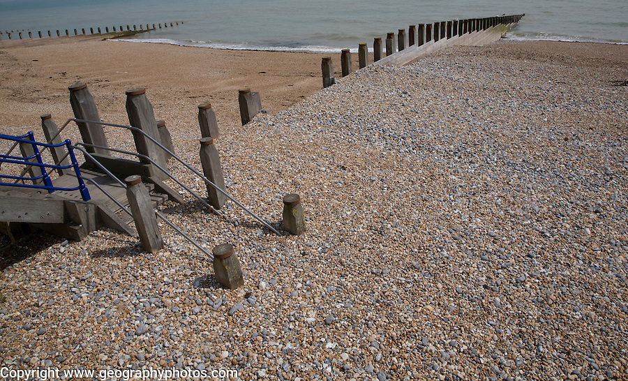 Wooden groyne showing different beach levels, Eastbourne, East Sussex, England