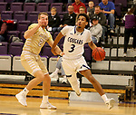 SIOUX FALLS, SD - NOVEMBER 25: Jerrod Walton #3 from the University of Sioux Falls drives past Turner Moen #21 from Southwest Minnesota State University during their game Saturday night at the Stewart Center in Sioux Falls. (Photo by Dave Eggen/Inertia)