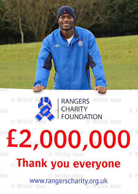 Maurice Edu with the total of £2M raised for the Rangers charity foundation