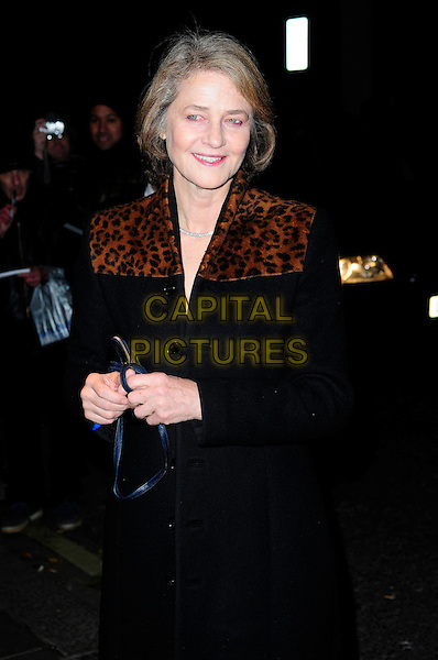 CHARLOTTE RAMPLING .London Evening Standard Theatre Awards, The Savoy, Strand, London.England, UK, November 28th 2010..half length black coat brown leopard animal print .CAP/CAS.©Bob Cass/Capital Pictures.