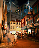 SINGAPORE, Boat Quay, tourists sitting in font of restaurant at night