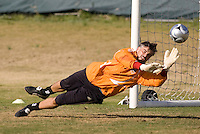 Houston Dynamo goalkeeper (18) Pat Onstad makes a save during a practice session at the RFK auxiliary field in Washington, DC on November 16, 2007.