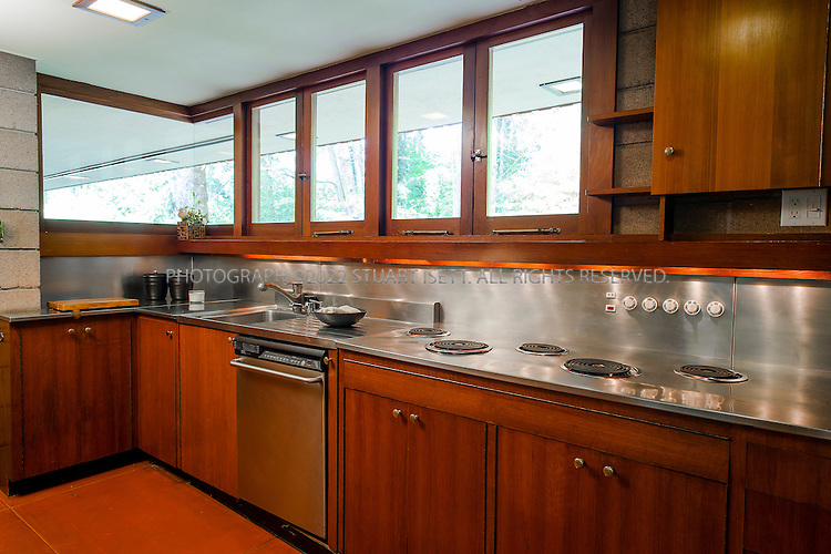 "10/9/2012--Sammamish, WA, USA..VIEW: Kitchen...Architect Frank Lloyd Wright planned his ""Usonian"" homes to be affordable for middle-class families. The 1,9500 square foot Brandes home is for sale in Sammamish, Washington (30 minutes from Seattle) at $1.39 million. It features three bedrooms, two bathrooms and a small, separate office/study space...The home was built in 1952, and has redwood trim and Wright's original furniture and some garden sculptures by Wright. It's one of only three Frank Lloyd Wright homes near Seattle...©2012 Stuart Isett. All rights reserved."