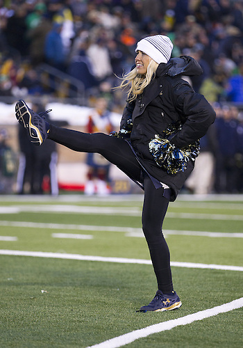 November 15, 2014:  Notre Dame cheerleader Molly Mohr performs during NCAA Football game action between the Notre Dame Fighting Irish and the Northwestern Wildcats at Notre Dame Stadium in South Bend, Indiana. Northwestern defeated Notre Dame 43-40 in overtime.