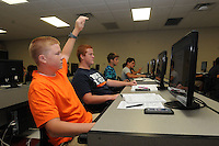 NWA Democrat-Gazette/FLIP PUTTHOFF<br /> Rogers Heritage High School students Seth Madewell (left) and Landon Evans work Tuesday Aug. 18 2015 in Project Lead The Way at the school.