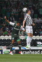 Kenny McLean beats Jorge Claros in the air in the St Mirren v Hibernian Clydesdale Bank Scottish Premier League match played at St Mirren Park, Paisley on 18.8.12.