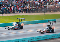 Oct 7, 2018; Ennis, TX, USA; NHRA top fuel driver Leah Pritchett (left) races alongside Clay Millican during the Fall Nationals at the Texas Motorplex. Mandatory Credit: Mark J. Rebilas-USA TODAY Sports