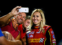 Sep 29, 2017; Madison , IL, USA; NHRA funny car driver Courtney Force takes a selfie with a fan during qualifying for the Midwest Nationals at Gateway Motorsports Park. Mandatory Credit: Mark J. Rebilas-USA TODAY Sports