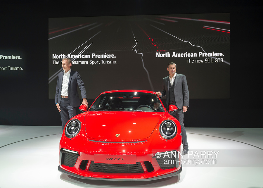 Manhattan, New York, USA. April 12, 2017.  R-L, KLAUS ZELLMER, President and Chief Executive Officer of Porsche Cars North America, Inc, and ANDREAS PREUNINGER, GT Project Director Porsche AG, introduce two new cars making their North American Premiere: Panamera Sport Turismo (silver car on left) and 911 GT3 (red car on right) during the Porsche Press Conference at the New York International Auto Show, NYIAS, during the first Press Day at the Javits Center.