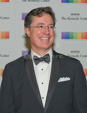 Stephen Colbert arrives for the formal Artist's Dinner honoring the recipients of the 38th Annual Kennedy Center Honors hosted by United States Secretary of State John F. Kerry at the U.S. Department of State in Washington, D.C. on Saturday, December 5, 2015. The 2015 honorees are: singer-songwriter Carole King, filmmaker George Lucas, actress and singer Rita Moreno, conductor Seiji Ozawa, and actress and Broadway star Cicely Tyson.<br /> Credit: Ron Sachs / Pool via CNP/MediaPunch