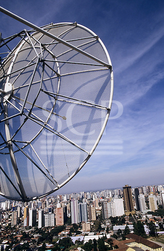 Curitiba, Brazil. Communications satelliete dish in the foreground with the city behind; Parana State.