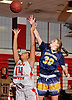 Shannon Bernhardt #30 of Massapequa, right, and Taylor Abraham #14 of Freeport battle for a rebound during a Nassau County AA-1 varsity girls basketball game at Freeport High School on Friday, Dec. 22, 2017. Massapequa won by a score of 43-39.