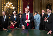 United States President Donald Trump is joined by the Congressional leadership and his family as he formally signs his cabinet nominations into law, Friday, Jan. 2017, in the President's Room of the Senate on Capitol Hill in Washington. Joining him from left are US Senator Roy Blunt (Republican of Missouri), US Vice President Mike Pence and his wife Karen Pence, Jared Kushner, President Trump's wife Melania Trump, Eric Trump, and Speaker of the US House Paul Ryan (Republican of Wisconsin). <br /> Credit: J. Scott Applewhite / Pool via CNP