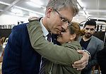 Lubna Yusef, a Christian woman displaced from Qaraqosh in 2014 by the Islamic State group, is hugged by the Rev. Dr. Olav Fykse Tveit, the general secretary of the World Council of Churches, after she told her story to members of an ecumenical delegation on January 23, 2017, during the group's visit to displaced settlements in Ankawa, in northern Iraq's Kurdistan region.