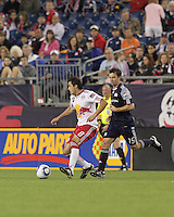 New York Red Bulls midfielder Sinisa Ubiparipovic (8) dribbles as New England Revolution forward Zack Schilawski (15) closes. The New England Revolution defeated the New York Red Bulls, 3-2, at Gillette Stadium on May 29, 2010.