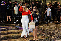Pictured: Two young women walk on the zebra crossing. Sunday 31 December 2017 and 01 January 2018<br /> Re: New Year revellers in Wind Street, Swansea, Wales, UK