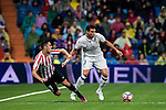Pepe (r) of Real Madrid battles for the ball with Sabin Merino of Athletic Club during their La Liga match between Real Madrid and Athletic Club at the Santiago Bernabeu Stadium on 23 October 2016 in Madrid, Spain. Photo by Diego Gonzalez Souto / Power Sport Images