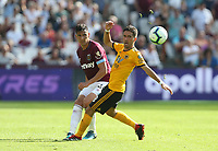 West Ham United's Fabian Balbuena and Wolverhampton Wanderers' Joao Moutinho<br /> <br /> Photographer Rob Newell/CameraSport<br /> <br /> The Premier League - West Ham United v Wolverhampton Wanderers - Saturday 1st September 2018 - London Stadium - London<br /> <br /> World Copyright © 2019 CameraSport. All rights reserved. 43 Linden Ave. Countesthorpe. Leicester. England. LE8 5PG - Tel: +44 (0) 116 277 4147 - admin@camerasport.com - www.camerasport.com